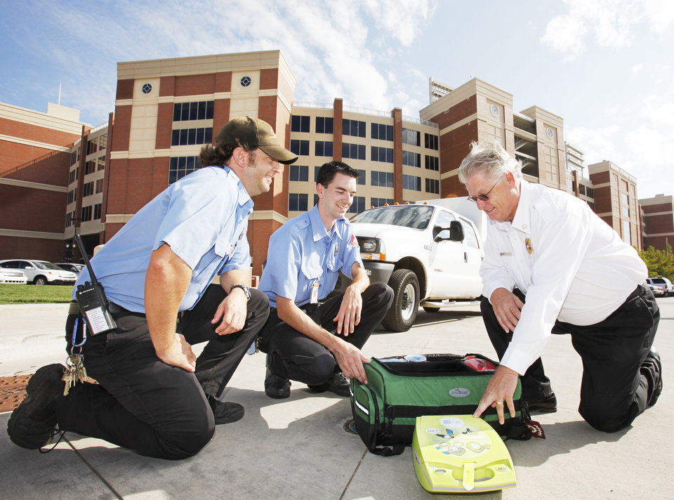 Emergency Medical Technicians James Isaacs and Matthew Williams look over emergency medical supplies with University Fire Marshal Floyd Cobb outside the OSU football stadium in Stillwater, Tuesday, August 31, 2010.       Photo by David McDaniel, The Oklahoman