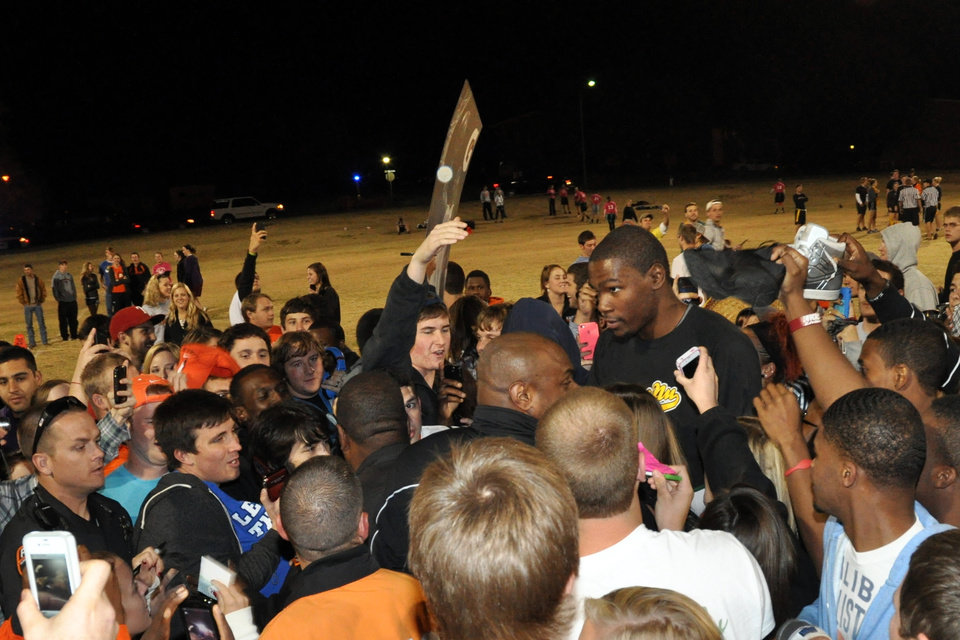 Photo - Kevin Durant signs autographs after an intramural flag football game with Sigma Nu fraternity at Oklahoma State University, Oct. 31, 2011. Photo submitted by S. Burner.