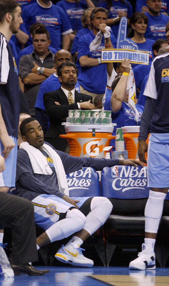 Photo - Denver's J.R. Smith (5) sits on the bench during the final seconds of the NBA basketball game between the Denver Nuggets and the Oklahoma City Thunder in the first round of the NBA playoffs at the Oklahoma City Arena, Sunday, April 17, 2011. Photo by Bryan Terry, The Oklahoman