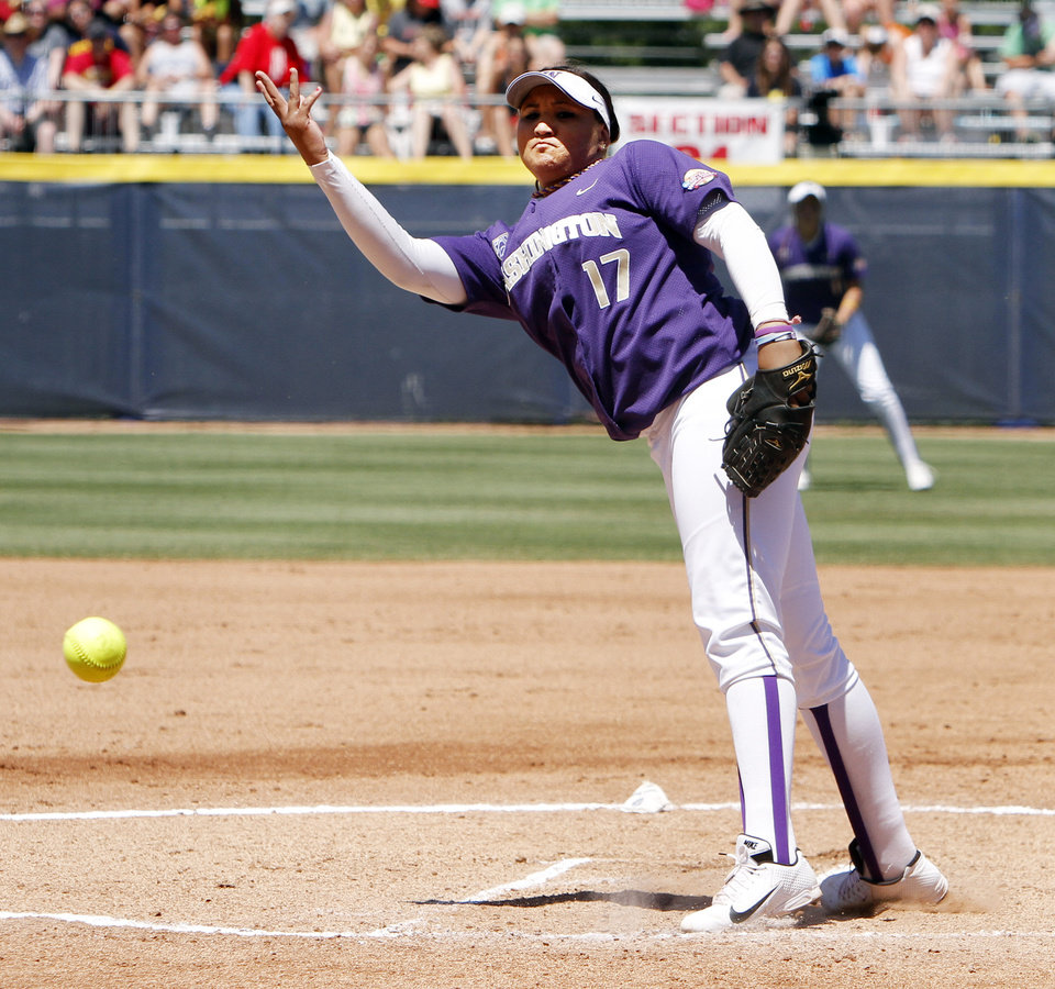 Photo - Washington Huskies pitcher Bryana Walker pitches in the first inning of the Women's College World Series elimination game versus Michigan. The Washington Huskies would go on to win 4-1 on June 2, 2013. Photo by KT KING, The Oklahoman