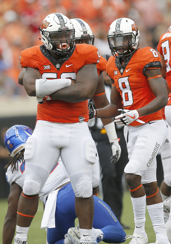 Photo - Oklahoma State's Enoch Smith Jr. (56) reacts to a defensive play in the third quarter during a college football game between the Oklahoma State Cowboys (OSU) and the Boise State Broncos at Boone Pickens Stadium in Stillwater, Okla., Saturday, Sept. 15, 2018. OSU won 44-21. Photo by Sarah Phipps, The Oklahoman
