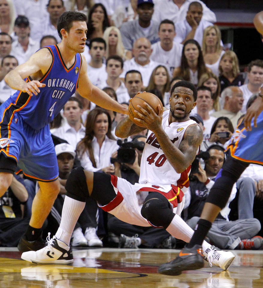 Photo - Oklahoma City's Nick Collison (4) defends Miami's Udonis Haslem (40) during Game 4 of the NBA Finals between the Oklahoma City Thunder and the Miami Heat at American Airlines Arena, Tuesday, June 19, 2012. Photo by Bryan Terry, The Oklahoman