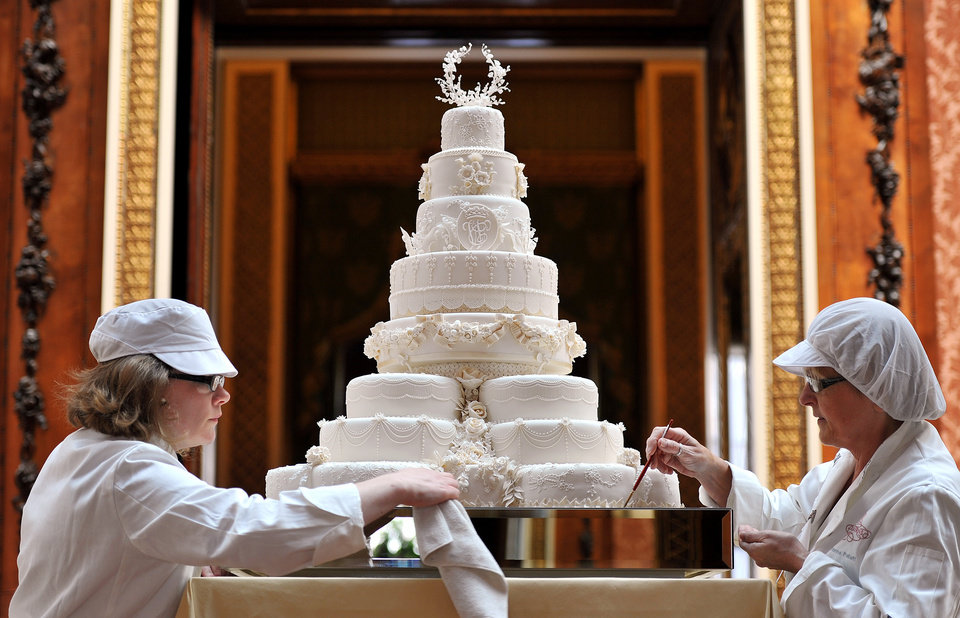 Photo - Rachel Jane Eardley. left, and Diane Pallett put the finishing touches to the Royal wedding cake, that Fiona Cairns and her team made for Prince William and Kate Middleton, in the Picture Gallery of Buckingham Palace in central London, Friday April 29, 2011. (AP Photo/John Stillwell/POOL)  ORG XMIT: RWJF105