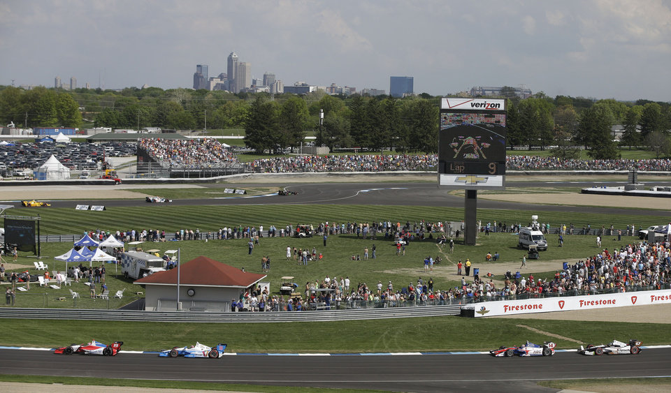 Photo - Drivers make their way around the track during the inaugural Grand Prix of Indianapolis IndyCar auto race at Indianapolis Motor Speedway in Indianapolis, Saturday, May 10, 2014. (AP Photo/Darron Cummings)