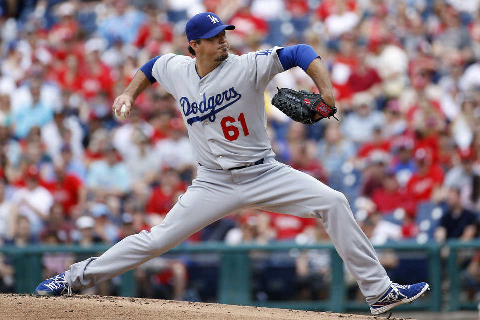 Photo - Los Angeles Dodgers' Josh Beckett pitches during the first inning of a baseball game against the Philadelphia Phillies, Sunday, May 25, 2014, in Philadelphia. (AP Photo/Matt Slocum)