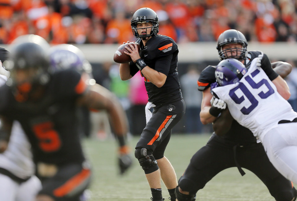 Photo - Oklahoma State's Wes Lunt (11) looks to pass during a college football game between Oklahoma State University (OSU) and Texas Christian University (TCU) at Boone Pickens Stadium in Stillwater, Okla., Saturday, Oct. 27, 2012. OSU won, 36-14. Photo by Nate Billings, The Oklahoman