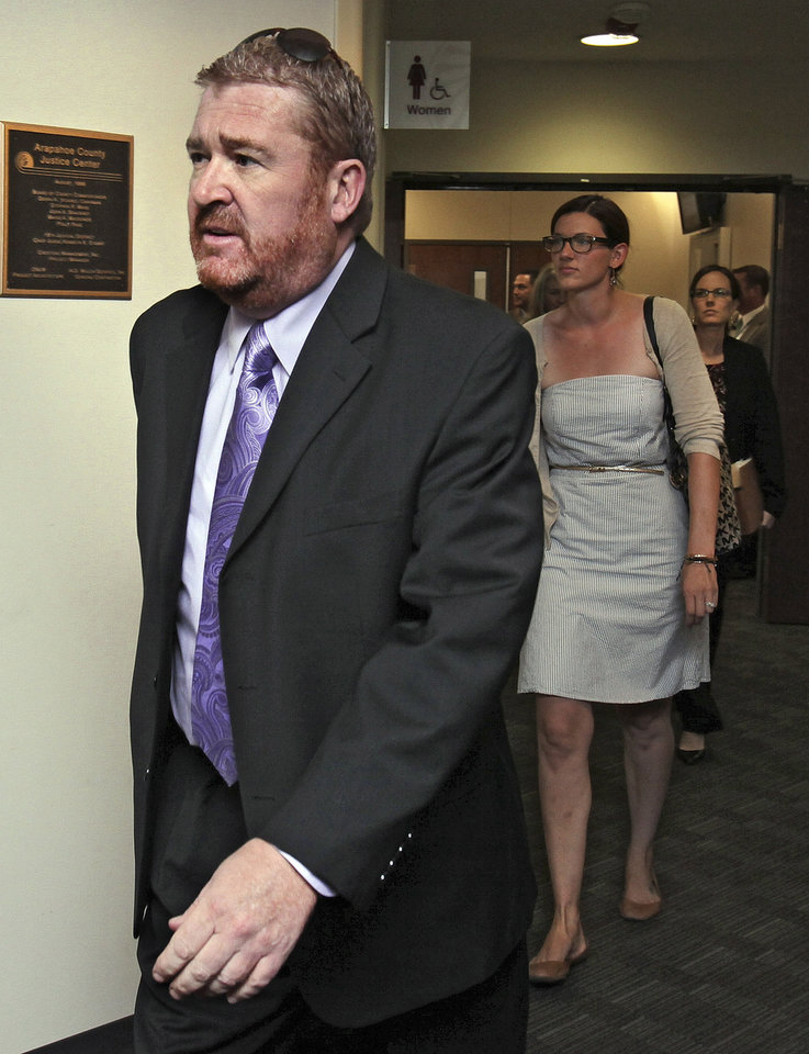 Photo -   Defense attorney Daniel King leads other public defenders into court for a motions hearing for suspected theater shooter James Holmes in district court in Centennial, Colo., on Thursday, Aug. 30, 2012. Holmes has been charged in the shooting at the Aurora theater on July 20 that killed twelve people and injured more than 50. (AP Photo/Barry Gutierrez)