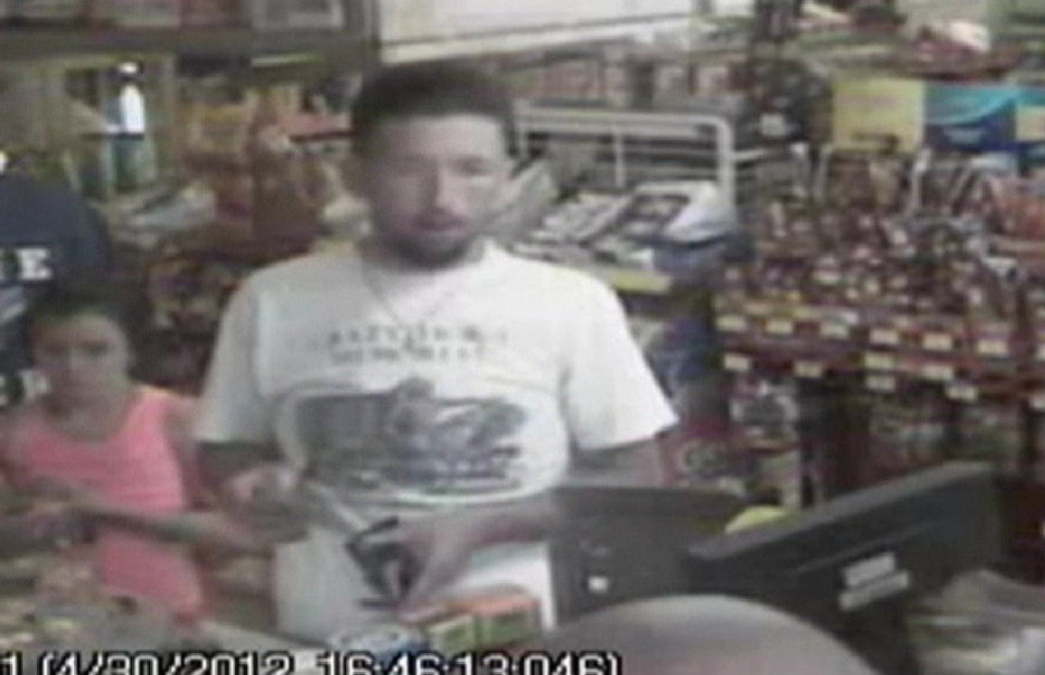 Photo -   In this photo made from surveillance video and released by the Tennessee Bureau of Investigation, Adam Mayes, 35, stands in front of the counter at a convenience store on April 30, 2012 in Union County, Miss., about three days after Jo Ann Bain and her daughters disappeared. Authorities say Mayes abducted Bain and her three daughters. Bain and her oldest daughter were found dead. The two younger girls are still missing. (AP Photo/Tennessee Bureau of Investigation)