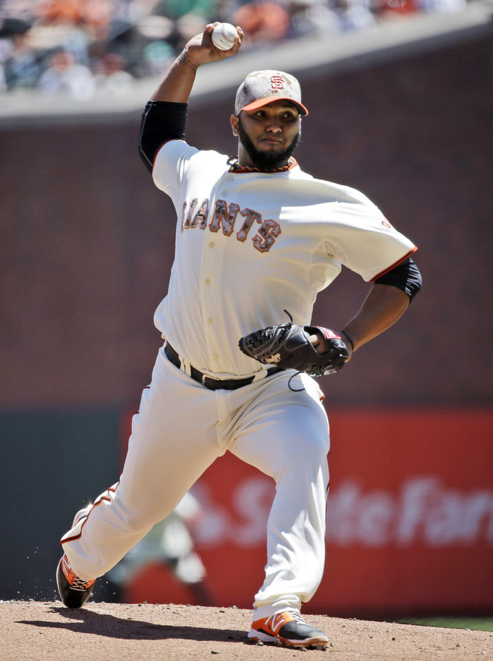 Photo - San Francisco Giants startin pitcher Yusmeiro Petit throws to the Chicago Cubs during the first inning of a baseball game on Monday, May 26, 2014, in San Francisco. (AP Photo/Marcio Jose Sanchez)