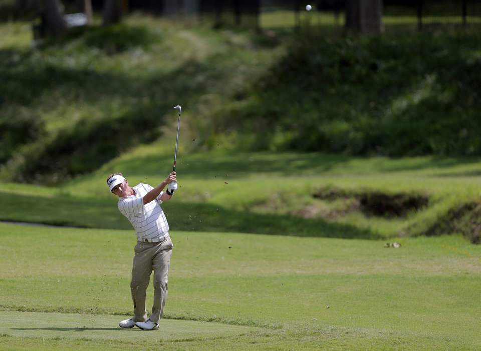 Photo - Willie Wood hits on 4th hole during the U.S. Senior Open golf tournament at Oak Tree National in Edmond, Okla., Thursday, July 10, 2014. Photo by Sarah Phipps, The Oklahoman