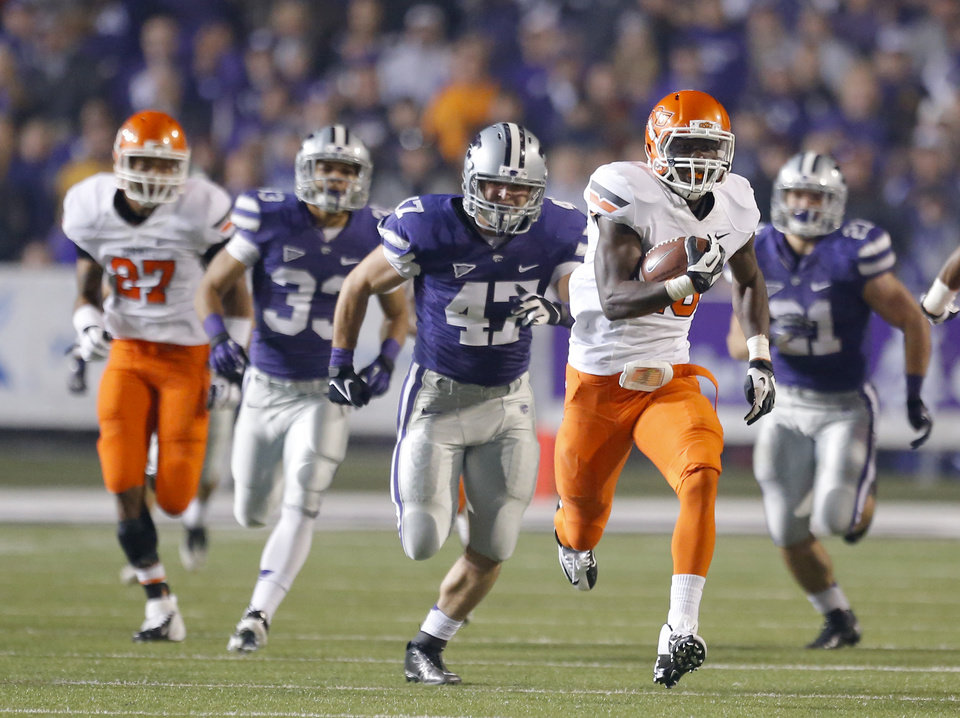 Photo - Oklahoma State's Desmond Roland (26) returns a kickoff for touchdown during the college football game between Kansas State University (KSU) and Oklahoma State (OSU) at  Bill Snyder Family Football Stadium in Manhattan, Kan.,  Saturday, Nov. 3, 2012. Photo by Sarah Phipps, The Oklahoman