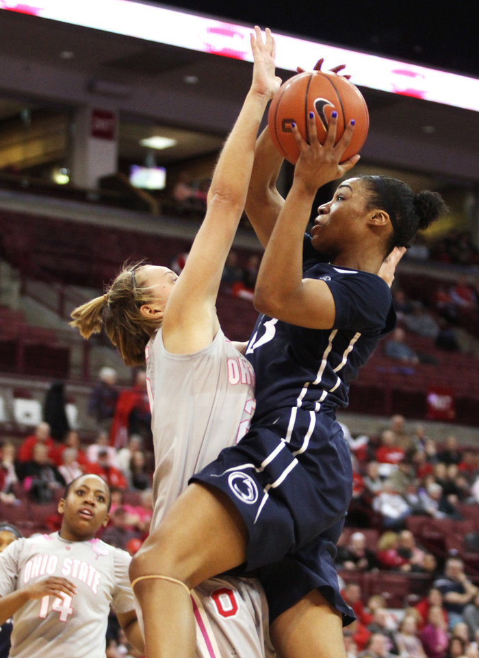 Photo - Penn State's Ariel Edwards, right, goes up against Ohio State's Peyton Whitted during the second half of an NCAA women's college basketball game, Sunday, Feb. 9, 2014, in Columbus, Ohio. Penn State won 74-54. (AP Photo/Mike Munden)