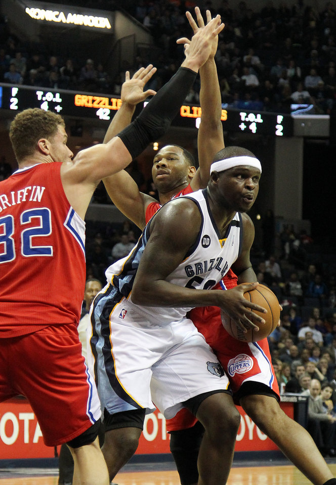 Memphis Grizzlies forward Zach Randolph (50) gets through Los Angeles Clippers defenders Blake Griffin (32) and Willie Green, back, in the second half of an NBA basketball game on Monday, Jan. 14, 2013, in Memphis, Tenn. The Clippers won 99-73. (AP Photo/Lance Murphey)