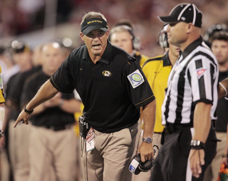 Photo - Missouri head coach Gary Pinkel argues an intentional grounding call during the college football game between the University of Oklahoma Sooners (OU) and the University of Missouri Tigers (MU) at the Gaylord Family-Memorial Stadium on Saturday, Sept. 24, 2011, in Norman, Okla. Photo by Steve Sisney, The Oklahoman