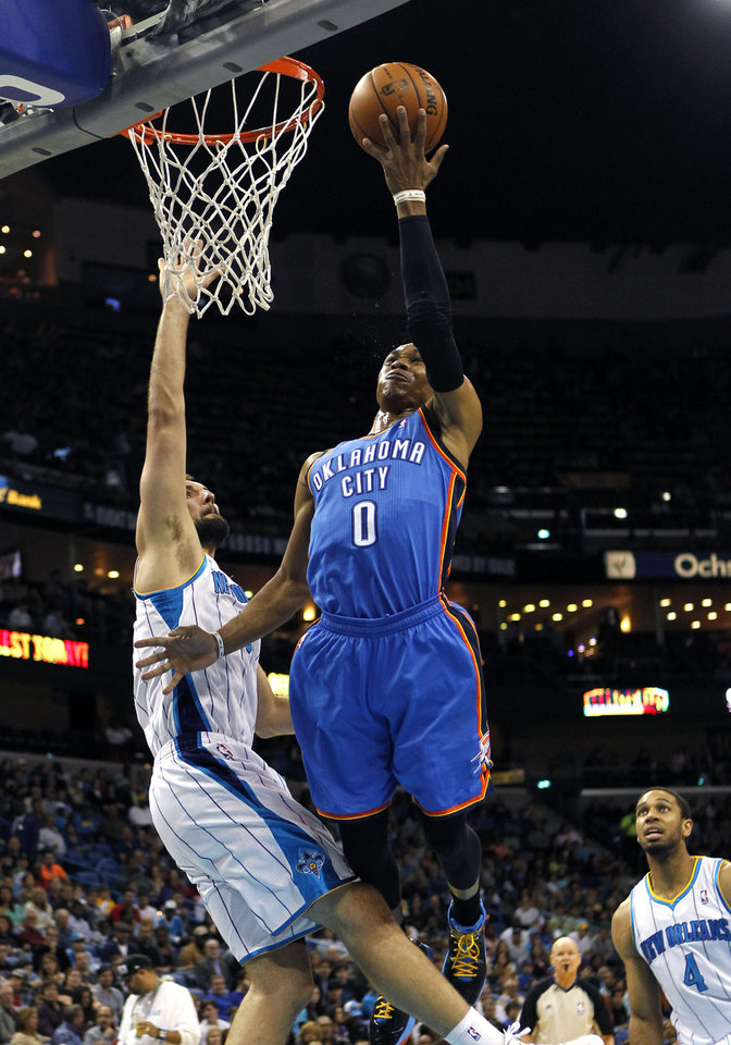 Photo - Oklahoma City Thunder guard Russell Westbrook (0) drives to the basket against New Orleans Hornets forward Ryan Anderson in the first half of an NBA basketball game in New Orleans, Saturday, Dec. 1, 2012. (AP Photo/Gerald Herbert)
