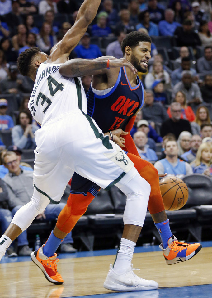 Photo - Oklahoma City's Paul George (13) drives against Milwaukee's Giannis Antetokounmpo (34) in the third quarter during an NBA basketball game between the Milwaukee Bucks and the Oklahoma City Thunder at Chesapeake Energy Arena in Oklahoma City, Sunday, Jan. 27, 2019. Oklahoma City won 118-112. Photo by Nate Billings, The Oklahoman