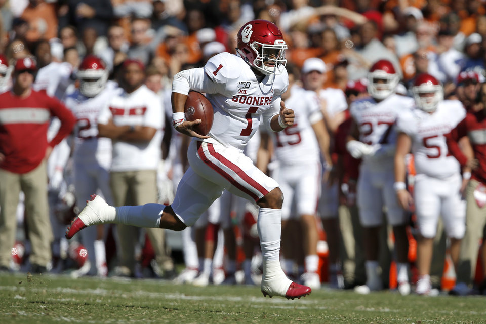 Photo - Oklahoma's Jalen Hurts (1) carries the ball during the Red River Showdown college football game between the University of Oklahoma Sooners (OU) and the Texas Longhorns (UT) at Cotton Bowl Stadium in Dallas, Saturday, Oct. 12, 2019. Oklahoma won 34-27. [Bryan Terry/The Oklahoman]