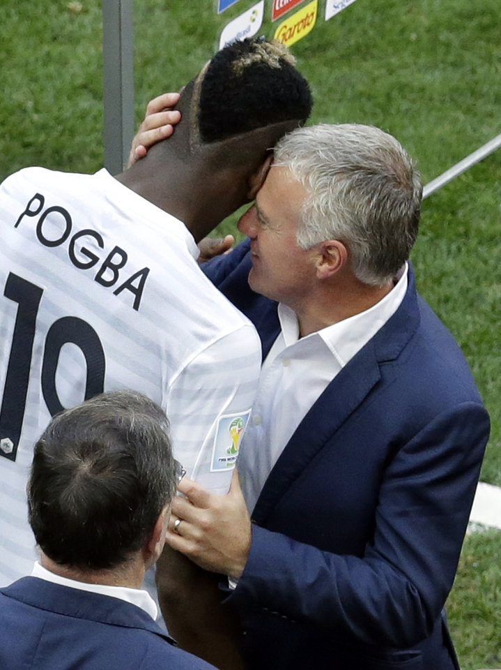Photo - France's Paul Pogba, left, is congratulated by head coach Didier Deschamps after the World Cup round of 16 soccer match between France and Nigeria at the Estadio Nacional in Brasilia, Brazil, Monday, June 30, 2014. France won 2-0 and advances to the quarterfinal. (AP Photo/Hassan Ammar)