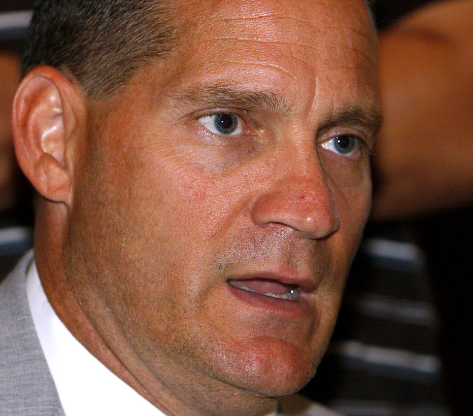 Photo - COLLEGE FOOTBALL: Iowa State University head coach Gene Chizik talks with the media during the Big 12 Conference Football Media Days at the Kansas City Marriott Downtown in Kansas City, Mo., on Wednesday, July 23, 2008. By John Clanton, The Oklahoman ORG XMIT: KOD