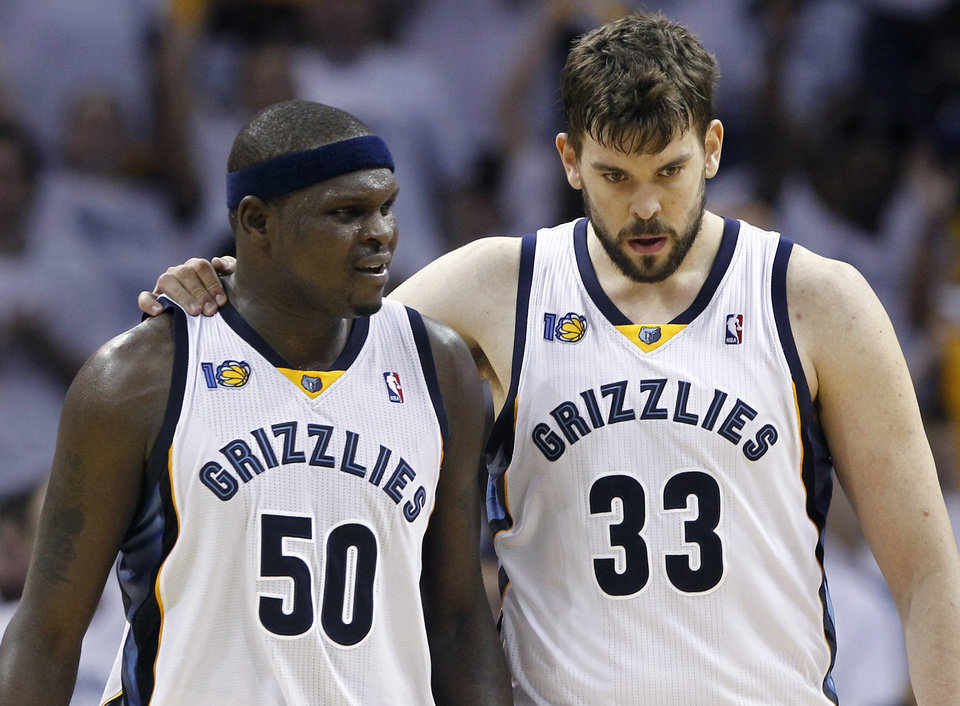 Photo - Memphis Grizzlies center Marc Gasol (33), of Spain, talks with forward Zach Randolph (50) during the first half against the Oklahoma City Thunder in Game 4 of a second-round NBA basketball playoff series on Monday, May 9, 2011, in Memphis, Tenn. (AP Photo/Wade Payne)