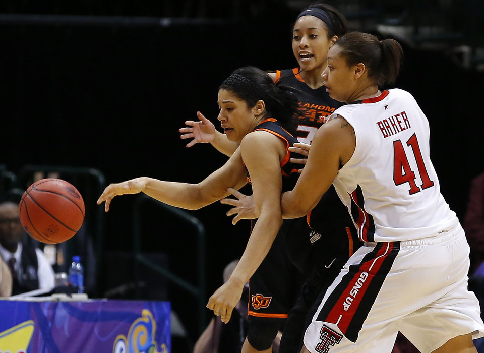 Oklahoma State's Brittney Martin (22) gains control of the ball in front of Texas Tech's Kelsi Baker (41) and Oklahoma State's Tiffany Bias (3) in the final minute of the Big 12 tournament women's college basketball game between Oklahoma State University and Texas Tech University at American Airlines Arena in Dallas, Saturday, March 9, 2012. Oklahoma State won 59-54.  Photo by Bryan Terry, The Oklahoman