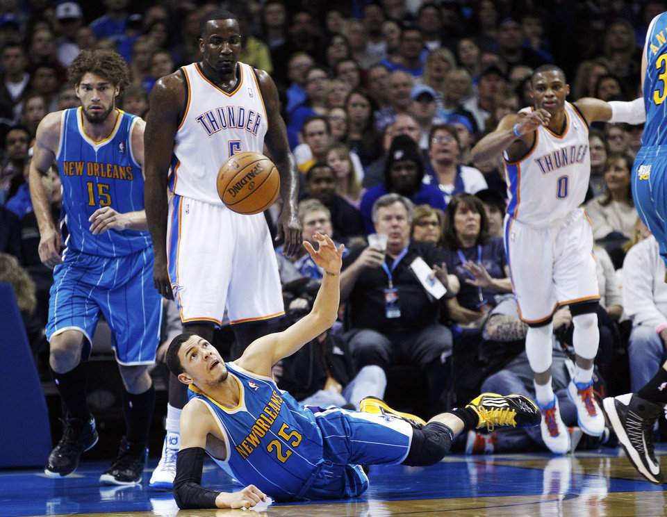 New Orleans Hornets guard Austin Rivers (25) reaches for a loose ball in front of Robin Lopez (15), Oklahoma City Thunder center Kendrick Perkins (5) and guard Russell Westbrook (0) in the second quarter of an NBA basketball game in Oklahoma City, Wednesday, Dec. 12, 2012. (AP Photo/Sue Ogrocki)