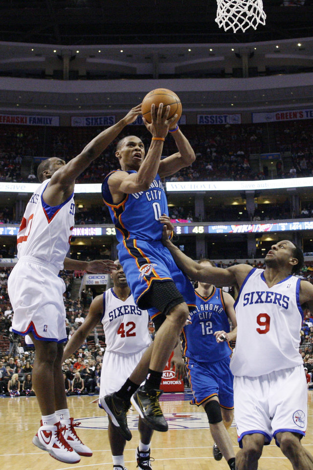 Photo - Oklahoma City Thunder's Russell Westbrook (0) goes up for a shot as Philadelphia 76ers' Jodie Meeks (20) and Andre Iguodala (9) defend in the first half of an NBA basketball game, Tuesday, March 30, 2010, in Philadelphia. (AP Photo/Matt Slocum) ORG XMIT: PXC106