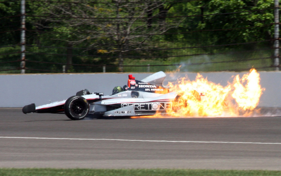 The car driven by Kurt Busch catches fire after hitting the wall in the second turn during practice for the Indianapolis 500 IndyCar auto race at the Indianapolis Motor Speedway in Indianapolis, Monday, May 19, 2014. (AP Photo/Mike Fair)
