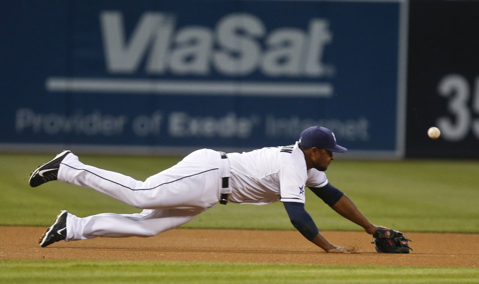 Photo - San Diego Padres third baseman Chris Nelson is late with the diving attempt on a base hit by Milwaukee Brewers' Aramis Ramirez in the first inning of a baseball game Monday, Aug. 25, 2014, in San Diego.  The hit drove in a run.  (AP Photo/Lenny Ignelzi)