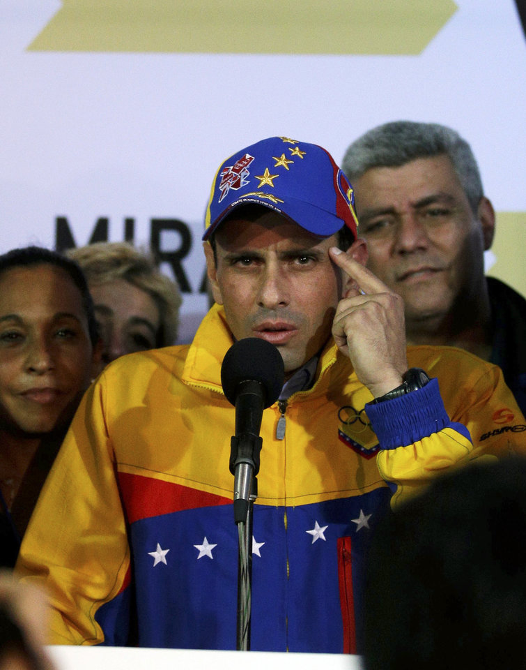 Photo - Miranda State's Gov. Henrique Capriles speaks after he was re-elected during an elections in Caracas, Venezuela, Sunday, Dec. 16, 2012. Capriles lost to Chavez in the country's October election, and his re-election Sunday will allow him to cement his position as Venezuela's dominant opposition leader, even as other opposition candidates floundered.(AP Photo/Fernando Llano)