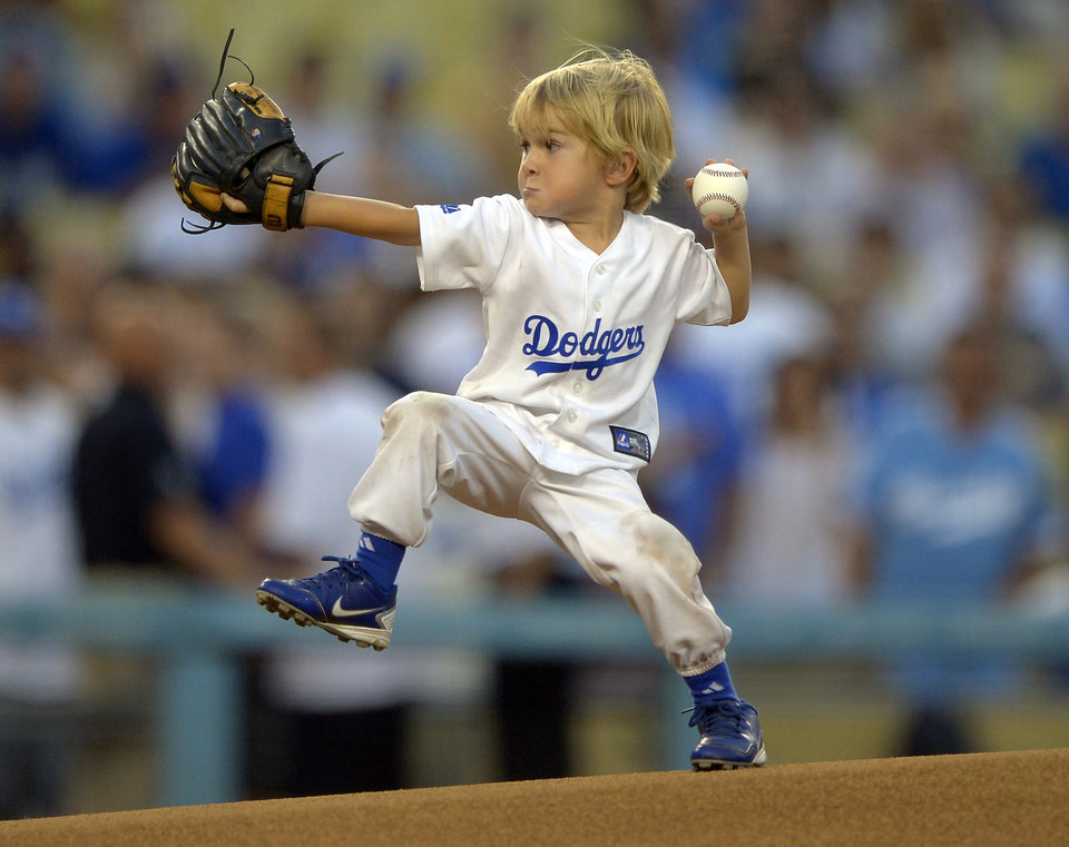 Photo -   Three-year-old actor Christian Haupt throws out the ceremonial first pitch prior to the Los Angeles Dodgers' baseball game against the San Diego Padres, Tuesday, Sept. 4, 2012, in Los Angeles. (AP Photo/Mark J. Terrill)