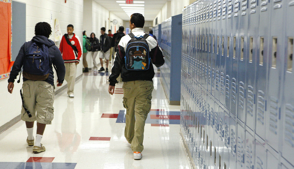 Students walk in a hallway between classes Tuesday at John Marshall Mid-High School.  Photos by Paul B. Southerland, The Oklahoman