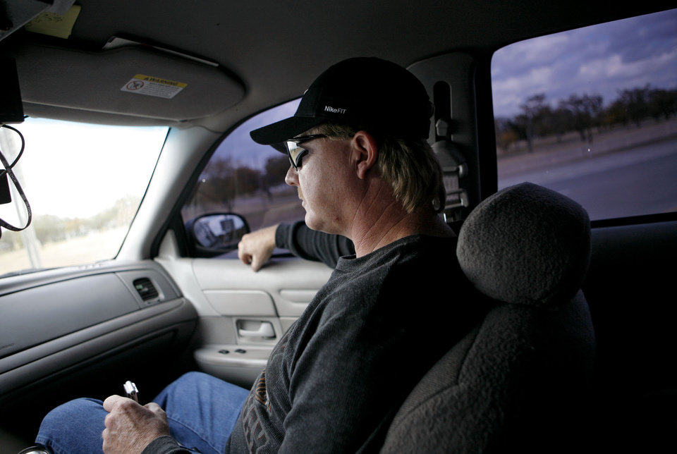 Lt. Darrell Southerland (left) of Lawton's Gang Task Force drives past Fort Sill in Lawton on Wednesday Nov. 5, 2008. By John Clanton, The Oklahoman ORG XMIT: KOD