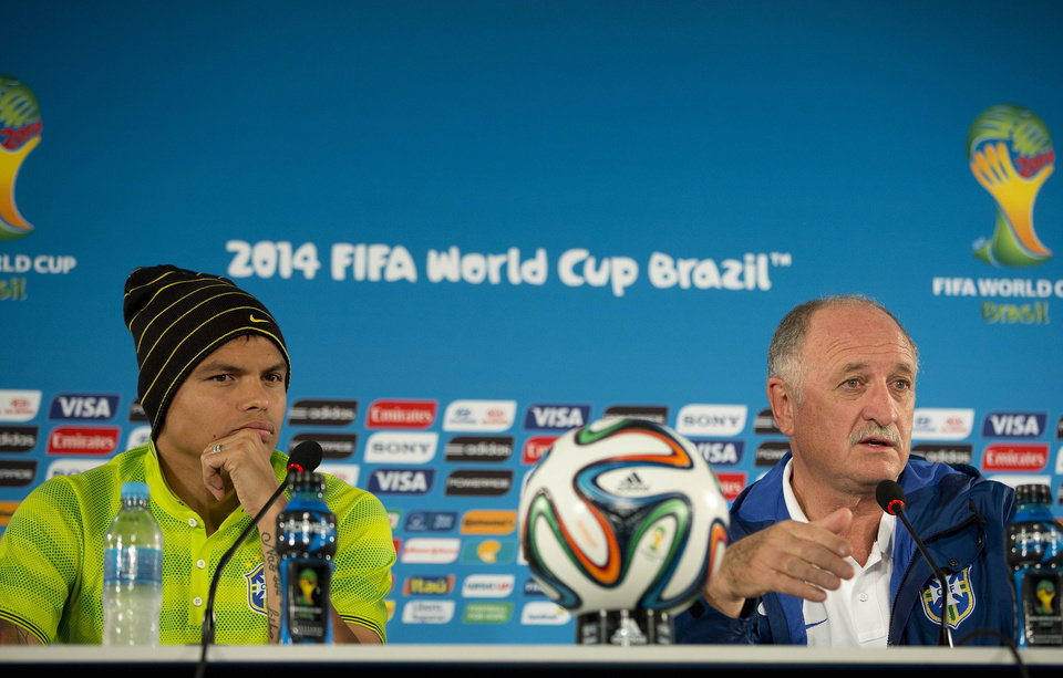 Photo - Brazil's coach Luiz Felipe Scolari, right, and player Thiago Silva attend a press conference one day before their team's World Cup third-place soccer match against the Netherlands at the Estadio Nacional in Brasilia, Brazil, Friday, July 11, 2014. (AP Photo/Andre Penner)