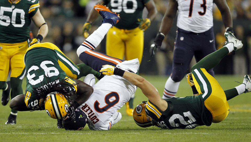 Photo -   FILE - In this file photo taken Sept. 13, 2012, Chicago Bears quarterback Jay Cutler is sacked by Green Bay Packers' Clay Matthews (52) and Erik Walden (93) during an NFL football game in Green Bay, Wis. Cutler didn't get much protection during the game and his leadership got called into question for his sideline tirade against J'Marcus Webb and comments after the Bears' loss. (AP Photo/Mike Roemer, File)