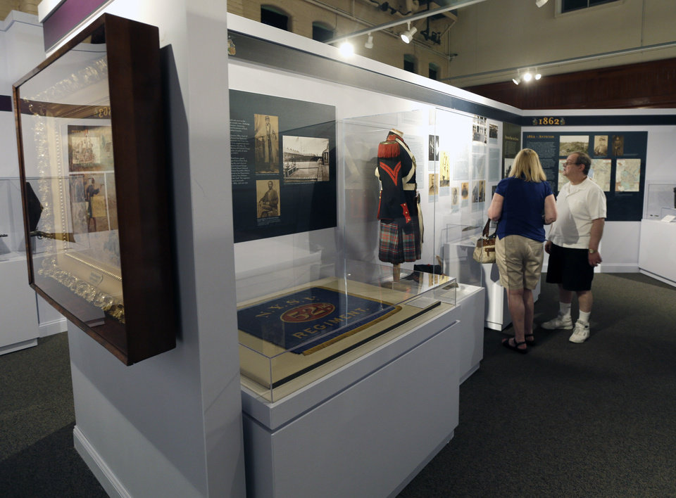 In this Wednesday, June 26, 2013 photo, Jerry and Ellen Davino, of River Edge, N.J., visit the New York for Union exhibit, a Civil War display highlighting artifacts from New York, at the New York State Military Museum, in Saratoga Springs, N.Y. (AP Photo/Mike Groll)