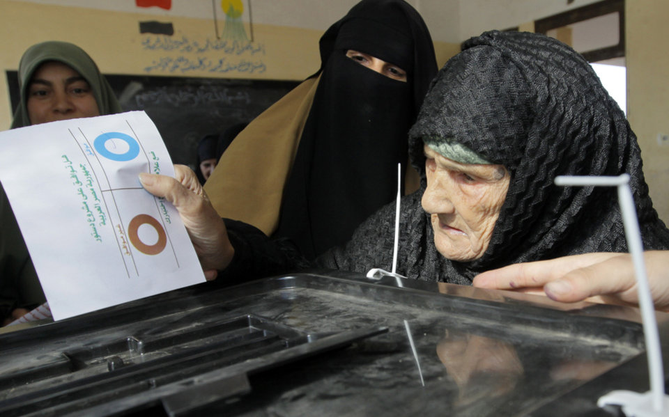 Photo - Amnah Sayyed Moussa, 85, casts her vote for the second round of a referendum on a disputed constitution drafted by Islamist supporters of President Mohammed Morsi in Giza, Egypt, Saturday, Dec. 22, 2012. (AP Photo/Amr Nabil)