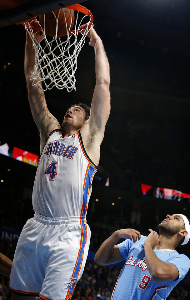 Photo - Oklahoma City 's Nick Collison (4) dunks in front of Los Angeles' J.J. Redick (4) during the NBA game between the Oklahoma City Thunder and the Los  Angeles Clippers at the Chesapeake Energy Arena, Sunday, Feb. 23, 2014. Photo by Sarah Phipps, The Oklahoman