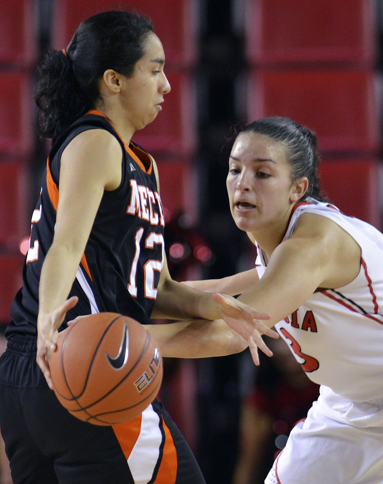Georgia's Anne Marie Armstrong (3) reaches in to attempt a steal on Mercer guard Jessica Prieto (12) during the second half of an NCAA college basketball game, Tuesday, Dec. 4, 2012, in Athens, Ga. Georgia won 80-38. (AP Photo/Richard Hamm)