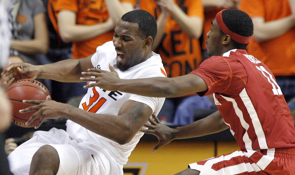 Photo - Oklahoma State's Matt Pilgrim (31) and Oklahoma's Calvin Newell Jr. (11) try to track down a loose ball during the Bedlam men's college basketball game between the University of Oklahoma Sooners and Oklahoma State University Cowboys at Gallagher-Iba Arena in Stillwater, Okla., Saturday, February, 5, 2011. Photo by Sarah Phipps, The Oklahoman