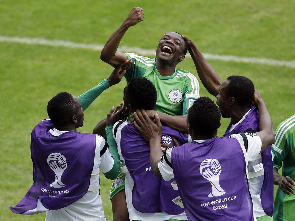 Photo - Nigeria's Ahmed Musa, center, celebrates with teammates after scoring his side's 2nd goal during the group F World Cup soccer match between Nigeria and Argentina at the Estadio Beira-Rio in Porto Alegre, Brazil, Wednesday, June 25, 2014. (AP Photo/Michael Sohn)