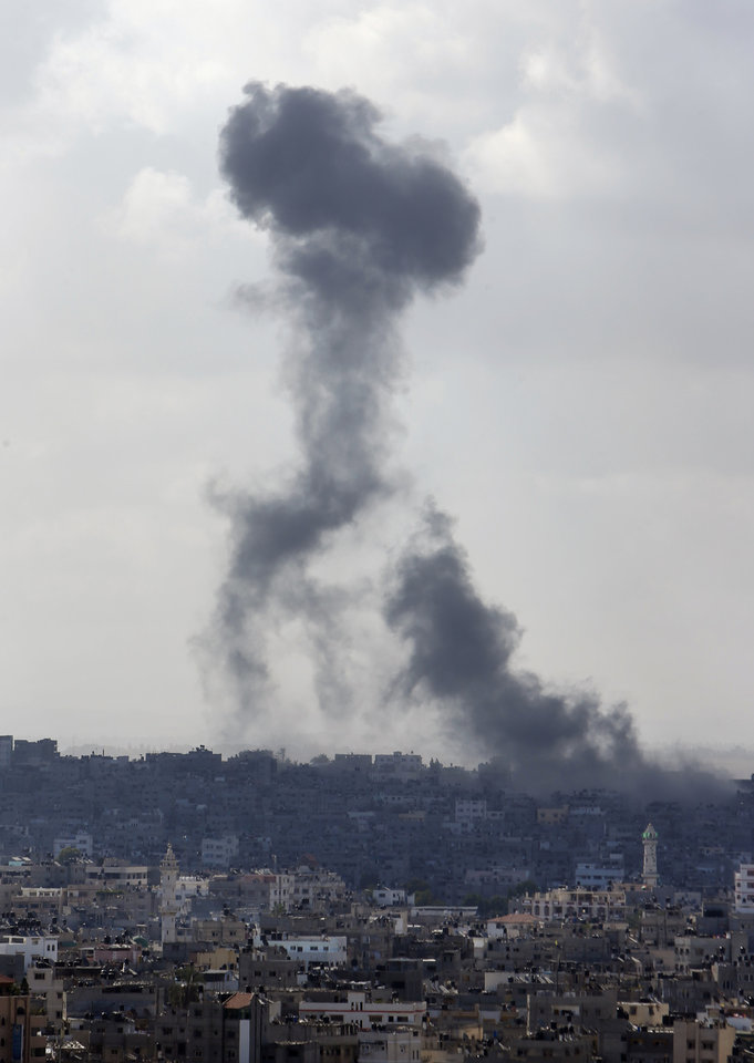 Photo - Smoke from an Israeli strike rises over the Gaza Strip, Friday, July 25, 2014. An Israeli defense official says the Israeli Security Cabinet is meeting to discuss international ceasefire efforts, but also the option of expanding its eight-day-old ground operation in Gaza. (AP Photo/Lefteris Pitarakis)
