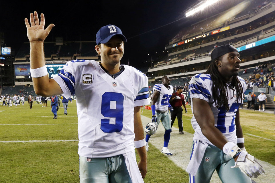 Dallas Cowboys quarterback Tony Romo, left, and wide receiver Dwayne Harris walk off the field after an NFL football game against the Philadelphia Eagles, Sunday, Nov. 11, 2012, in Philadelphia. Dallas won 38-23. (AP Photo/Julio Cortez)