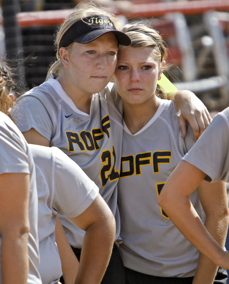 Photo - Members of the Roff softball team Taylor Canida (21) and Casey Kelley (5) react to their loss to Ft. Cobb during the Class 2A state championship softball tournament at ASA Hall of Fame Stadium on Wednesday, May 2, 2012, in Oklahoma City, Oklahoma. Photo by Chris Landsberger, The Oklahoman