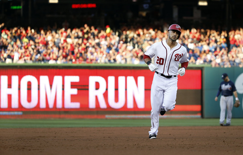 Photo - Washington Nationals' Ian Desmond rounds the bases for his solo home run during the second inning of a baseball game against the Atlanta Braves at Nationals Park on Friday, June 20, 2014, in Washington. (AP Photo/Alex Brandon)
