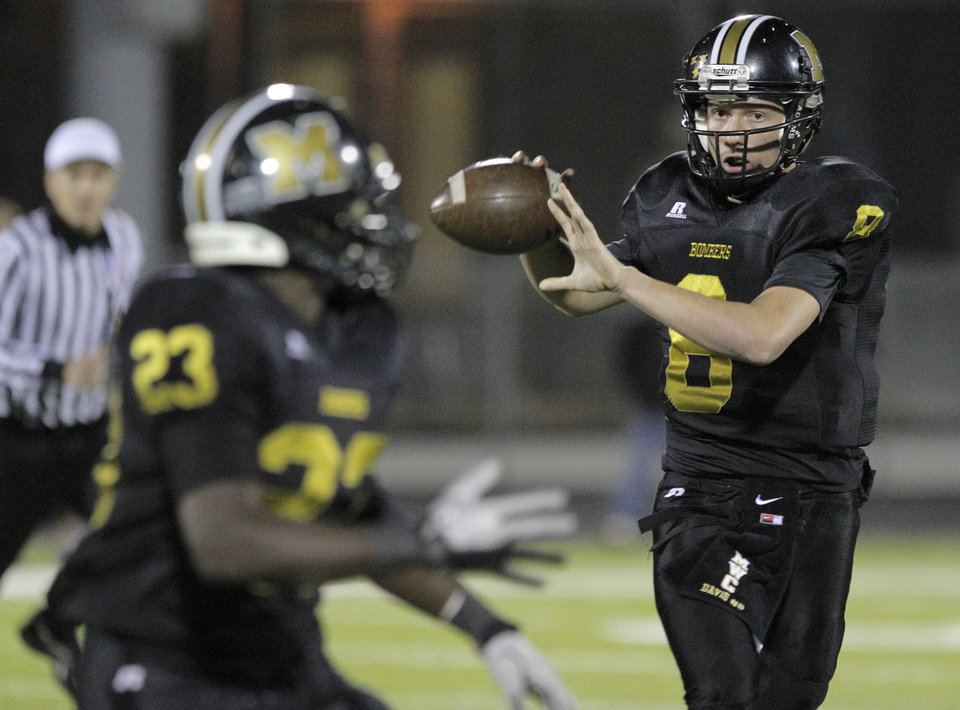 Photo - Midwest City's Joel Davis (8) throws the ball to Qualan Johnson (23) during a high school football game between Midwest City and Westmoore in Midwest City, Friday, Nov. 11, 2011.  Photo by Garett Fisbeck, for The Oklahoman