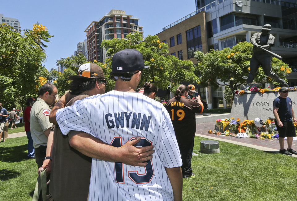 Photo - Two mourner console each other at the Tony Gwynn