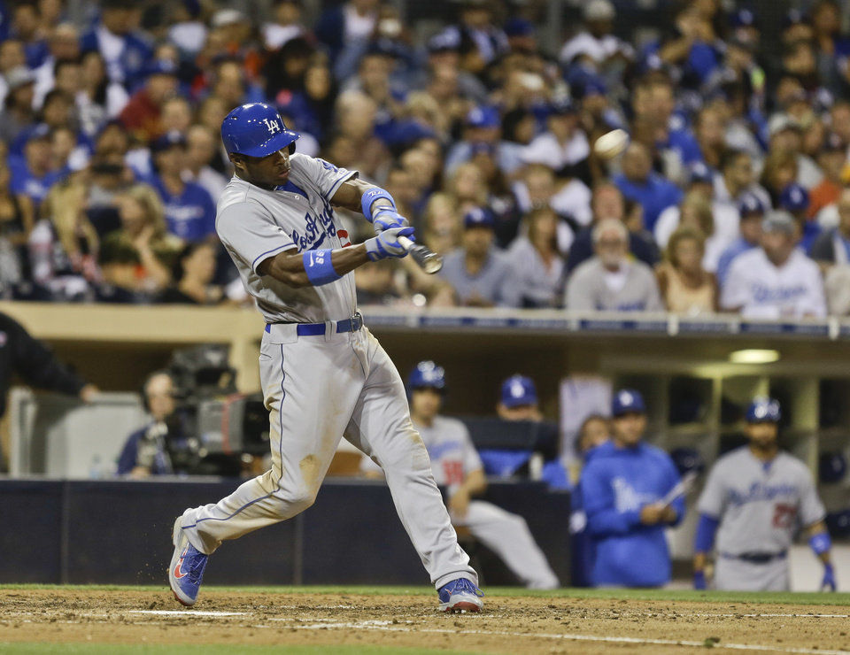 Photo - Los Angeles Dodgers' Yasiel Puig hits a two-run homer to center field against the San Diego Padres in the seventh inning of a baseball game Saturday, Sept. 21, 2013, in San Diego. (AP Photo/Lenny Ignelzi)