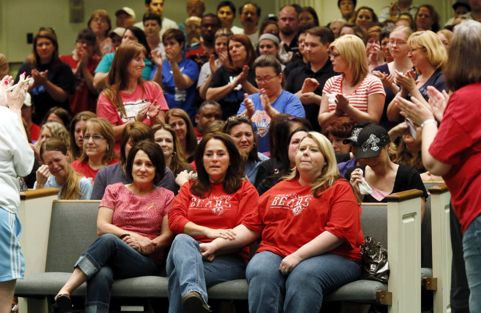 Photo - Briarwood Elementary staff members receive a standing ovation during a district-wide meeting of Moore Public Schools employees at Southern Hills Baptist Church, 8601 Pennsylvania Ave., in Oklahoma City, Wednesday, May 22, 2013. The school was destroyed when a tornado struck south Oklahoma City and Moore, Okla., on Monday. Photo by Nate Billings, The Oklahoman