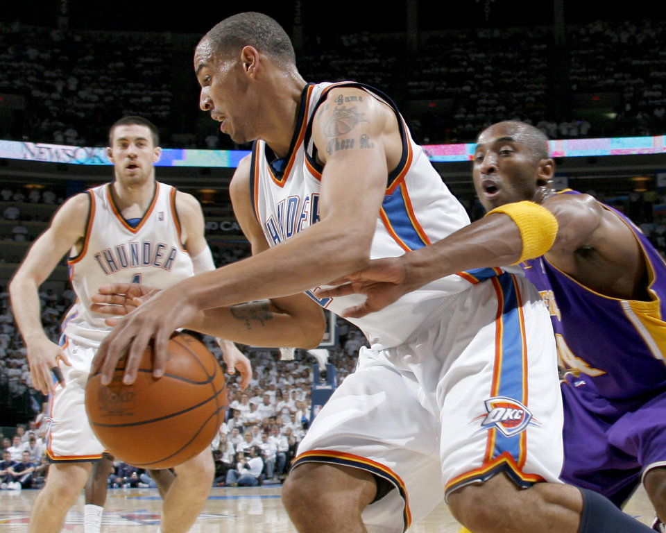 Photo - Kobe Bryant of the Lakers defends Oklahoma City's Thabo Sefolosha during the NBA basketball game between the Los Angeles Lakers and the Oklahoma City Thunder in the first round of the playoffs at the Ford Center in Oklahoma City, Saturday, April 24, 2010. Photo by Nate Billings, The Oklahoman ORG XMIT: KOD